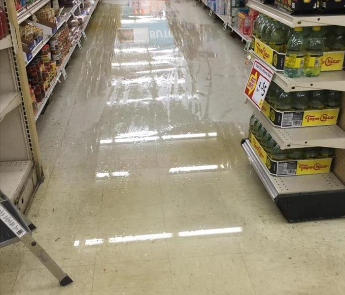 flooded isle at the local grocery store with standing water