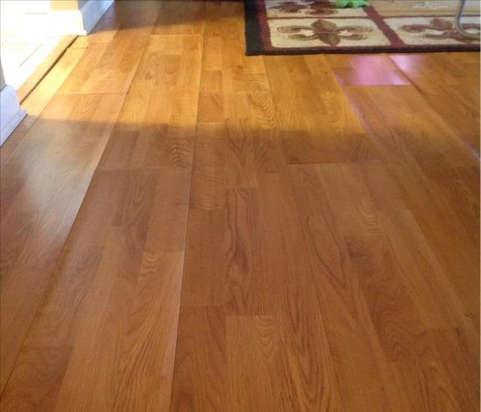 Flooded Laminate flooring in Natchitoches, LA Before